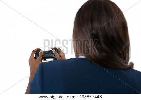Rear view of businesswoman playing video game against white background