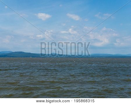 Choppy water on Lake Champlain with clouds in sky