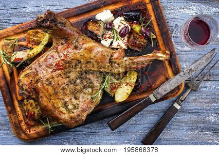 Barbecue Lamb Shoulder with Vegetables and Feta as top view on cutting board