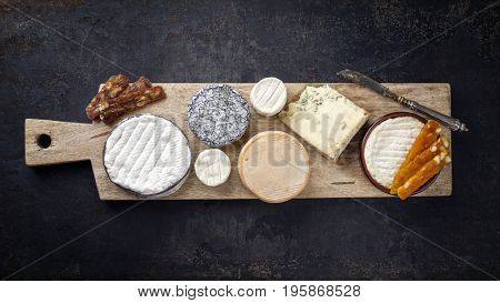 French Cheese Platter with Spanish Dulce de Membrillo as top view on a wooden board