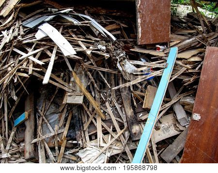 Background of a lot of construction debris laths. Wooden waste after construction or repair