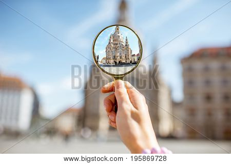 Watching through a magnifying glass on the church of Our Lady in Dresden, Germany