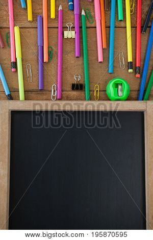 Close-up of school supplies arranged on wooden table