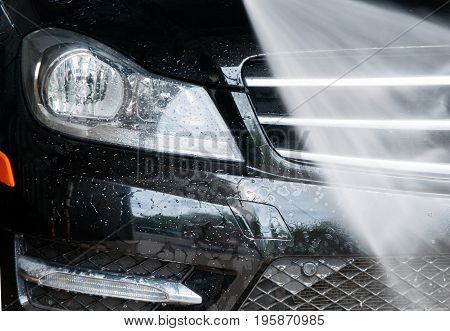 Car Washing. Modern Car Covered By Water.