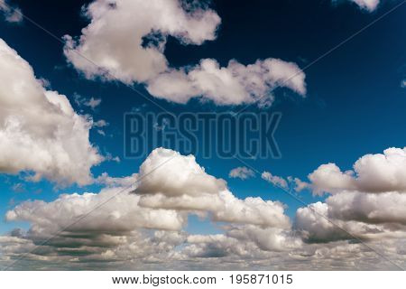 Fantastic soft white clouds against blue sky, natural composition