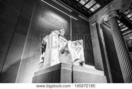 The statue of Abraham Lincoln sitting in a chair at Lincoln Memorial in Washington