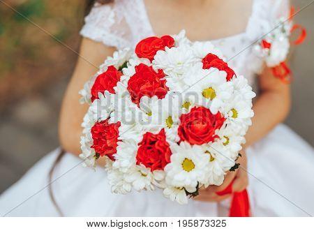 Little girl holding a bridal bridal bouquet