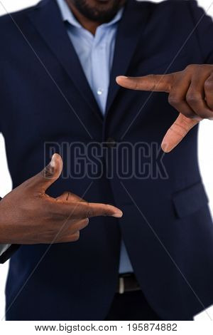 Mid section of businessman forming a finger frame