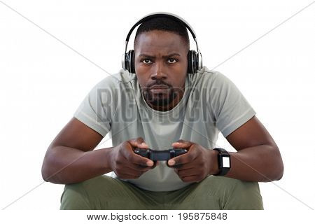 Concentrate man playing video games against white background