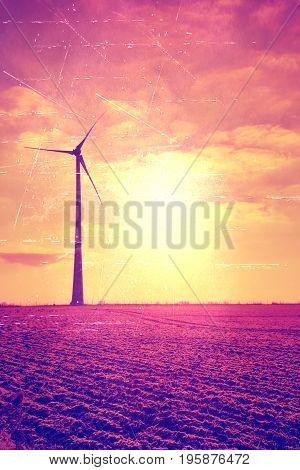 Film grain effect. Turning wind turbine on sunrice shaddow of propeller