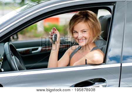 Young Happy Woman Showing The Key Of New Car.