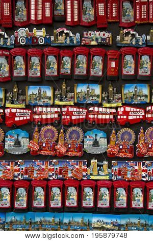 LONDON, UK - JUNE 5 , 2017: Magnets of red booth,parliament, or red double decker bus.  Great souvenirs of London, UK.