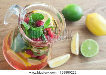 detox water with raspberries lime mint for weightloss in jug. Diet detoxication weightloss