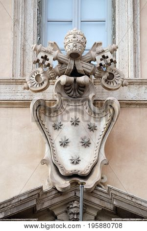 ROME, ITALY - SEPTEMBER 01: Papal coat of arms, facade of the Church of the Gesu, mother church of the Society of Jesus, Rome, Italy on September 01, 2016.