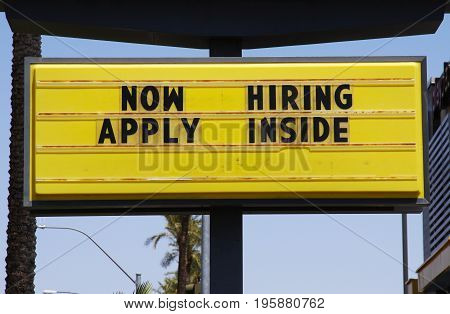 Now Hiring - Apply Inside billboard sign