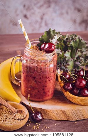 Cherry kale smoothie with flax seeds on table