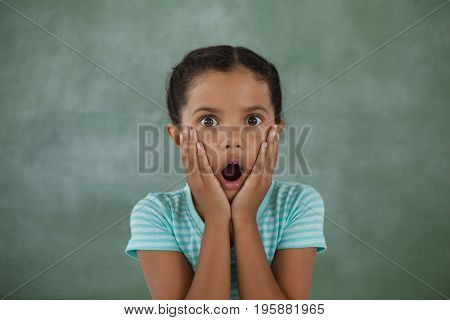 Portrait of surprised young girl