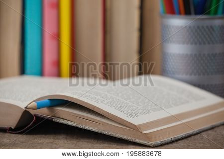 Close-up of book on wooden background