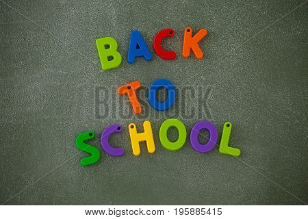 Close-up of block letters arranged on chalkboard