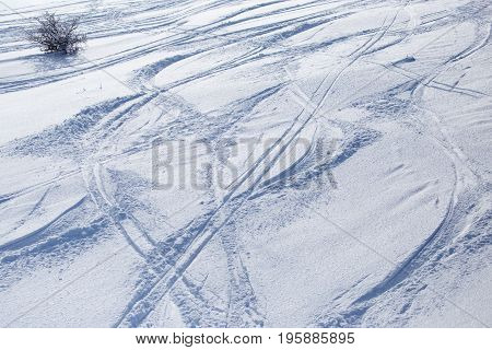 Traces of skis on snow as background .