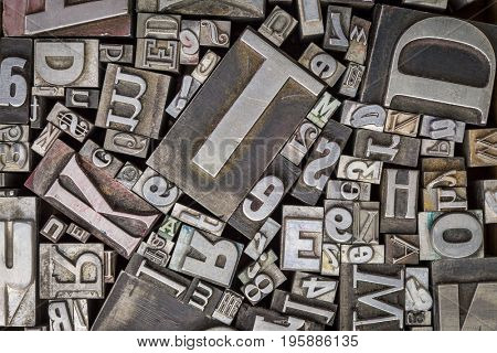background of vintage letterpress metal type printing blocks