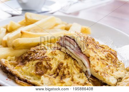 omelet with ham French fries