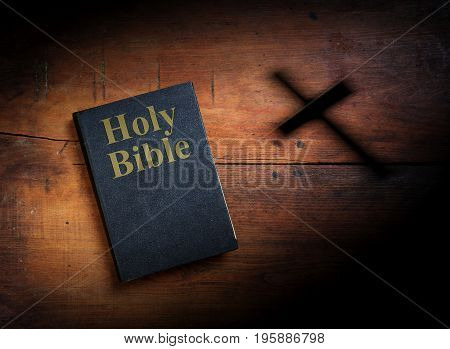 Old Holy Bible on wooden planks background