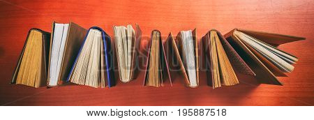 Vintage Books Standing On Wooden Background - Top View