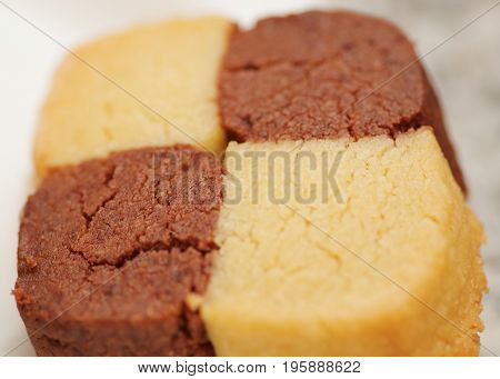 Closeup of Freshly baked cookies, chocolate and vanilla on white background.