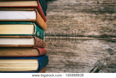 Vintage Books Stack On Wooden Background - Copy Space