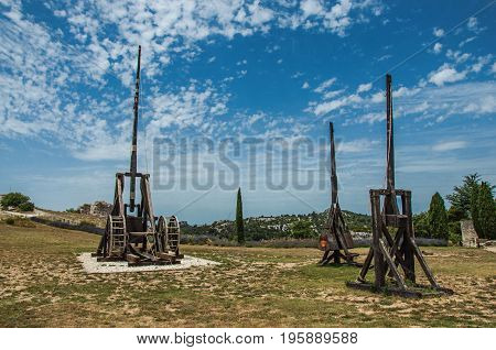 View of catapults under sunny blue sky, in the castle of Baux-de-Provence. Located in the Bouches-du-Rhône department, Provence-Alpes-Côte d'Azur region, in southeastern France