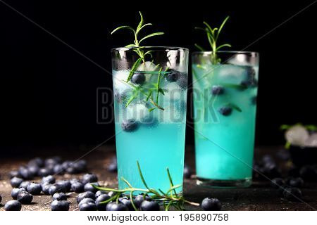 citrus lemonade with ice cubes,rosemary and blueberries