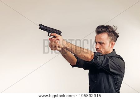 Boy targets the gun, he's about to shoot