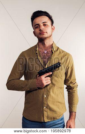 Boy with gun on white background