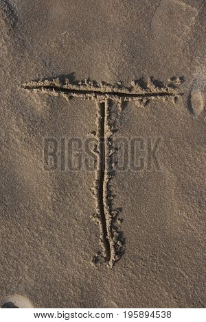 Letters handwritten on the beach sand alphabet