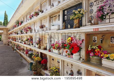 ROME ITALY - JULY 2 2017: Christian Concrete loculi tombs in the Verano cemetery burial recess built in the seventies