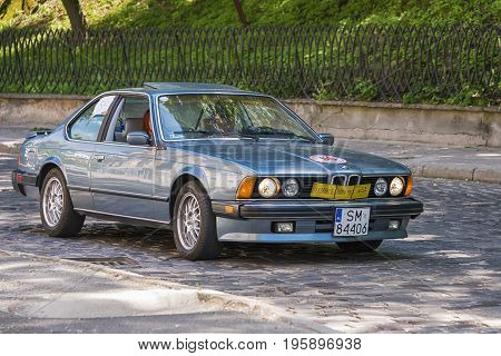 Lviv Ukraine - June 4 2017: Old retro car BMW 528 with its owner and au unknown passenger taking participation in race Leopolis grand prix 2017 Ukraine.