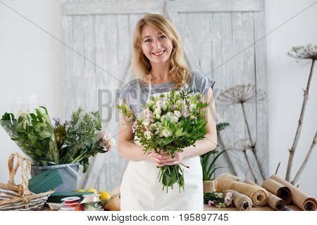Florists blonde working with flowers