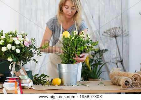 Florist with bouquet of flowers
