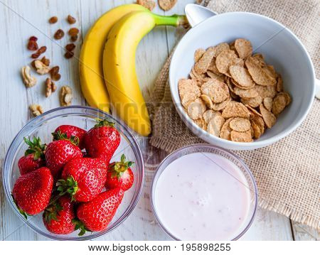 Healthy Breakfast which included cornflakes and oatflakes, yogurt, bananas and strawberries