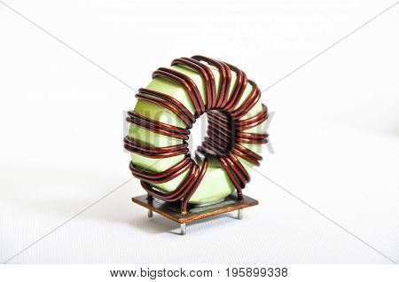 Transformer copper coil isolated on a white background