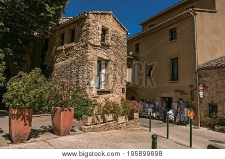 Lourmarin, France - July 07, 2016. View of quiet alley with stone buildings and shops in the lovely village of Lourmarin. Located in the Vaucluse department, Provence region, southeastern France