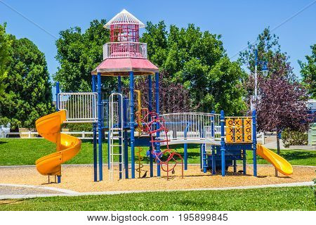 Children's Playground In Small Local Park Setting