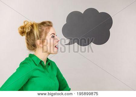 Woman Holding Black Thinking Bubble