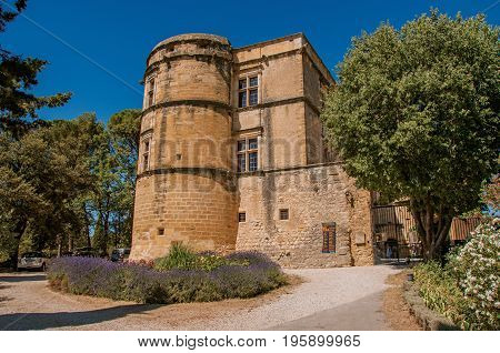 View of the Lourmarin castle with lavender bush in front, near the village of Lourmarin. In the Vaucluse department, Provence-Alpes-Côte d'Azur region, southeastern France