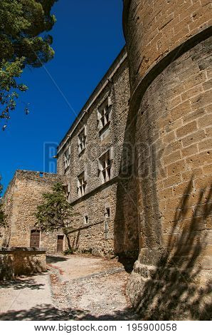 Close-up of the Lourmarin castle walls and tower, near the village of Lourmarin. In the Vaucluse department, Provence-Alpes-Côte d'Azur region, southeastern France