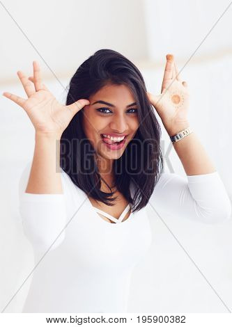 Beautiful Young Indian Woman Making Funny Faces