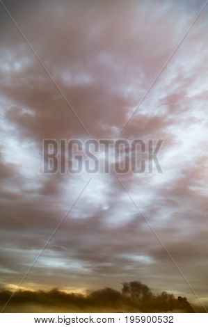 Background of beautiful rain clouds at sunset
