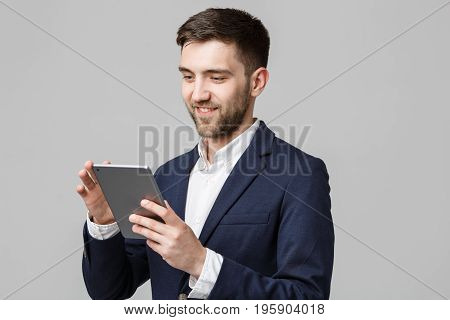 Business Concept - Portrait Handsome Business man playing digital tablet with smiling confident face. White Background.Copy Space.