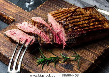Sliced Grilled Medium Rare Beef Steak Served On Wooden Board Barbecue, Bbq Meat Beef Tenderloin. Top